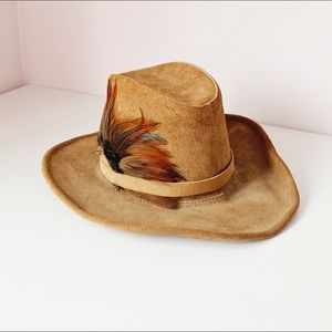 tan leather tall crown hat w/ decorative feathers